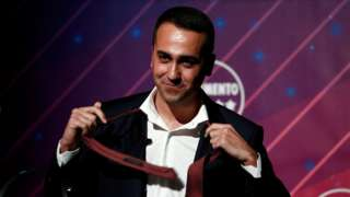 Italy's Foreign Minister Luigi Di Maio takes off his tie during a news conference in Rome, Italy, January 22, 2020