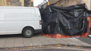 Black covering and a builder's van