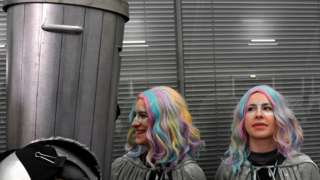 Count Binface and two supporters, both with multi-coloured hair