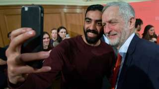 Jeremy Corbyn takes a selfie with a supporter
