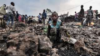 Child sits on the rubble