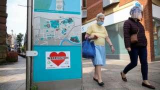 Women in masks in Warrington