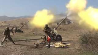 A still image taken from video footage published 20 October 2020 on the official website of the Azerbaijan's Defence Ministry shows allegedly artillery units of the Azerbaijani army fire during military combat with forces of the Nagorno-Karabakh