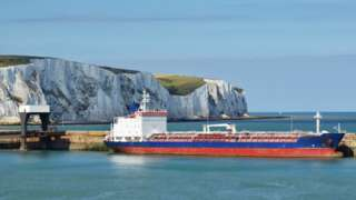A freight ship in the port of Dover