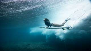 Maya Gabeira photographed underwater during a surfing session