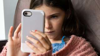 Stock image of a girl using a smartphone
