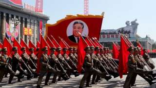 Servicemen march during a military parade marking the 70th anniversary of the foundation of North Korea.