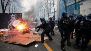 """Police officers remove a barricade during a demonstration against the """"Global Security Bill"""""""", that right groups say would make it a crime to circulate an image of a police officer""""s face and would infringe journalists"""" freedom in the country, in Paris, France, on 5 December 2020."""