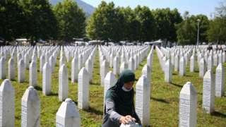 A woman at a graveyard