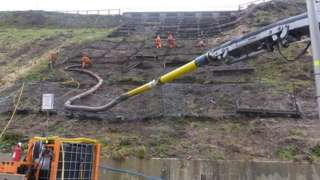 Engineers removing 1970s cliff retention materials