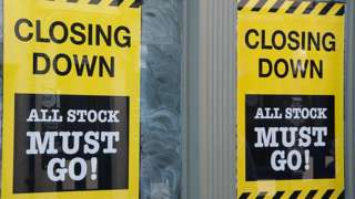 closing down signs in shop window