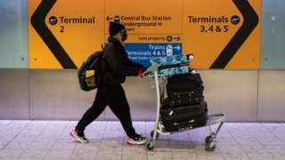Woman wearing face mask in an airport