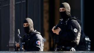 French Police secure the area near the Paris courthouse