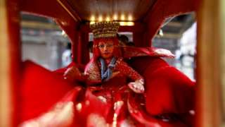 An idol of the Living Goddess Kumari is pictured inside the miniature chariot kept on display during the annual festival of Indra Jatra which is cancelled due to the spread of the coronavirus disease (COVID-19) in Kathmandu, Nepal September 2, 2020