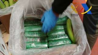 Spanish police display packages of cocaine which were seized in a shipment of bananas from Colombia in a container in the port of Algeciras.