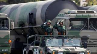 """Chinese troops salute in front of nuclear-capable missiles during a massive parade to mark the 60th anniversary of the founding of the People""""s Republic of China in Beijing - 2009 photo"""