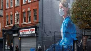 Mural of masked woman in Manchester