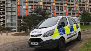 A police van outside the flats