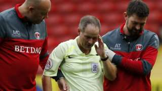 Robert Lewis is left concussed in a collision while refereeing Charlton v Doncaster