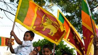 Children holding Sri Lankan flags after the election of Gotabaya Rajapaksa