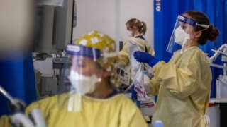 """Nurses work on patients in the Intensive Care Unit (ICU) in St George""""s Hospital in Tooting in early January 2021"""