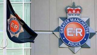 Greater Manchester Police badge and flag