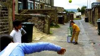 Boys playing cricket in Bradford in 2001