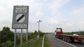 Traffic passes a border sign at Newry as you enter Northern Ireland from the Republic of Ireland