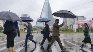 People wear masks on the streets of Pyongyang, North Korea. File photo