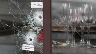 Bullet holes in a window of a Paris restaurant after 13 November 2015 attacks