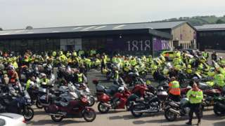 Motorcyclists gathering before funeral