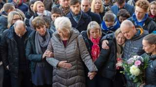 The family of Jack Merritt take part in a vigil at the Guildhall in Cambridge