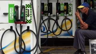 Staff person saying no petrol in petrol pump because of strike at Lotus Petrol Pump at Andheri
