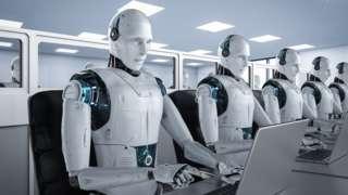 A row of human-like robots at computers