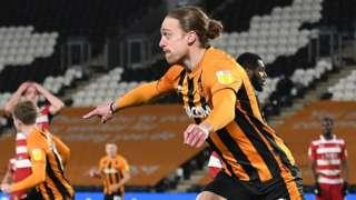 Tom Eaves celebrates his winning goal for Hull