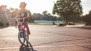 Girl on a bike generic image