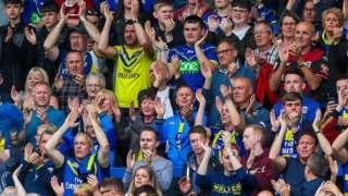 Warrington fans show their appreciation at the Halliwell Jones