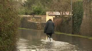 Flooding in the village of Siddington, south of Cirencester on the River Churn