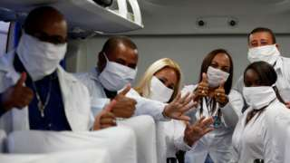 A group of doctors in Havana pose for a picture inside a plane headed to South Africa - 25 April 2020.