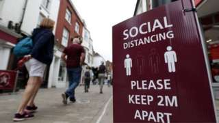 Bolton town centre with social distancing sign