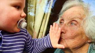 Young child and his great grandma