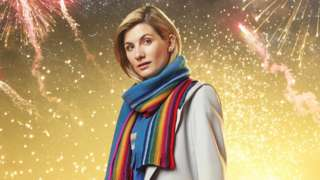 Jodie Whittaker wearing a multi-coloured scarf, as the Doctor.