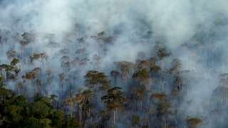 Smoke billows during a fire in an area of the Amazon rainforest near Porto Velho, Rondonia State, Brazil, September 10, 2019.