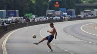 Man playing football on M4