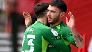 Scott Hogan celebrates his goal against Middlesbrough with Jon Toral