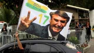 A supporter of Jair Bolsonaro, celebrates in front of his condominium at Barra da Tijuca in Rio de Janeiro, Brazil October 29, 2018