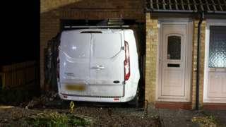Van crashed into house