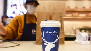 A staff member works in a Luckin Coffee outlet in Hangzhou in east China's Zhejiang province.