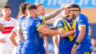Warrington celebrate a try against Hull KR