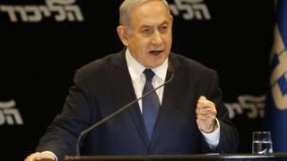 Israeli Prime Minister Benjamin Netanyahu speaks at a press conference regarding his intention to file a request to the Knesset for immunity from prosecution, in Jerusalem on January 1, 2020